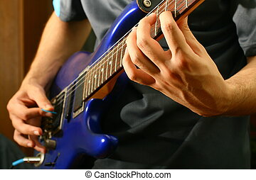 guitar solo - man play solo on blue guitar