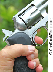 magnum revolver - close up of hand holding a 357 magnum...