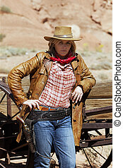 Portrait of beautiful cowgirl. Western movie style