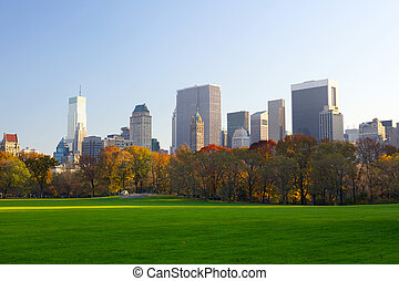 Manhattan skyline and Central Park - Central Park in autumn...