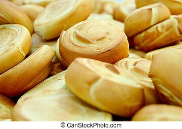 Fresh baked rolls in a industrial bakery - Many fresh baked...