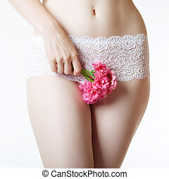 Abdomen and thighs with a bunch of flowers - The image of...