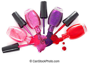 ?olored nail polish spilling from bottles - Image of...