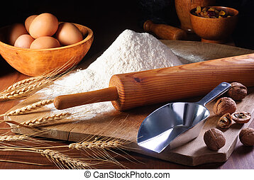 Flour and ingredients - Rolling pin and flour on an old...