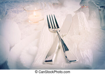Christmas table setting. Fork and knife in elegant holiday...
