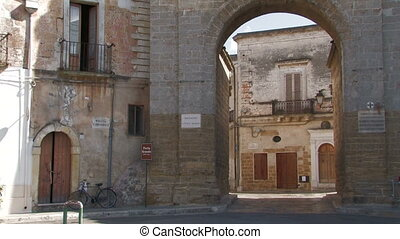 Medieval city gate into a village in southern Italy