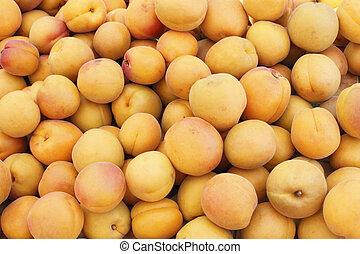 Many Peaches at a Market