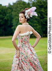 Princess in an vintage dress in nature - A woman like a...