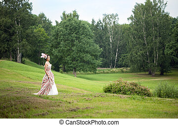 Princess in an vintage dress in nature