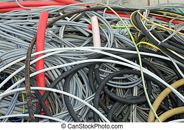 tangle of insulated copper wire in a landfill