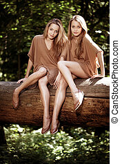 Beautiful twins in the forest