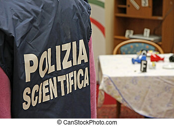 Italian scientific police inside a crime scene - Italian...