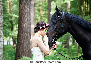 Woman and horse - Beautiful woman and a dark horse