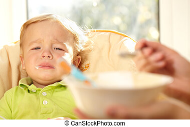 Kid is very disappointmented about porridge. - I don't want...