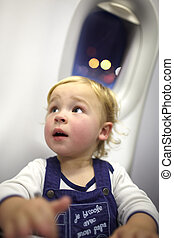 Young passenger in the plane Beautiful bokeh lights in the...