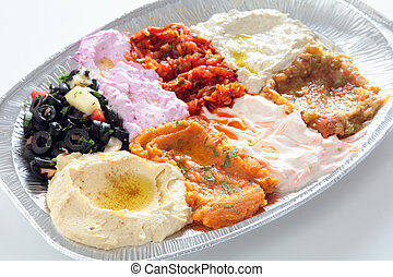 Arab or Turkish mezze plate - A restaurant take-away plate...