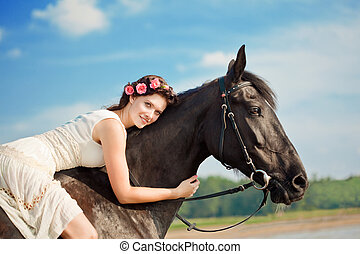 Woman on a horse by the sea - Image of a woman on a horse by...