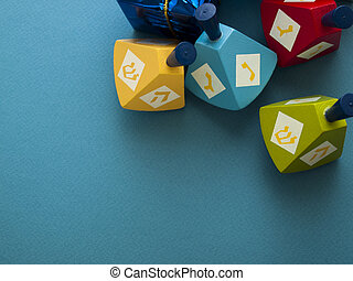 Dreidels - Colorful dreidels with presents on blue...