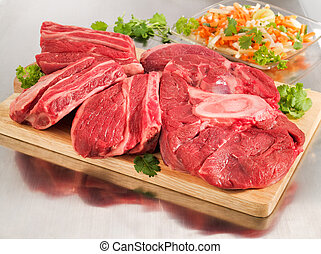 Raw beef shank on a cutting board - Raw beef shank steak on...