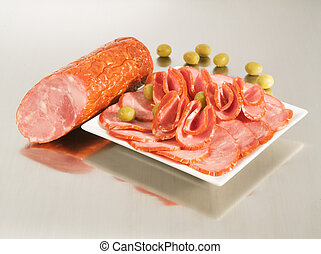 Arrangement with fresh Dry Krakow Sausage on a steel silver...