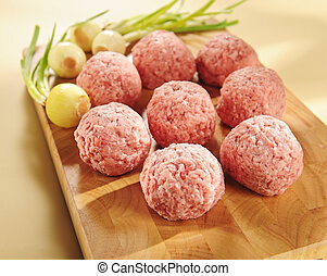 Minced delicatessen meat. Arrangement on a cutting board. -...