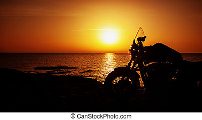 Motorcycle on sunset - Picture of luxury motorcycle on the...