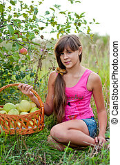 Teen girl with a basket of apples