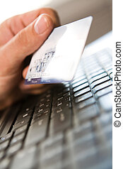 E-commerce - Close-up of human hand holding plastic card...