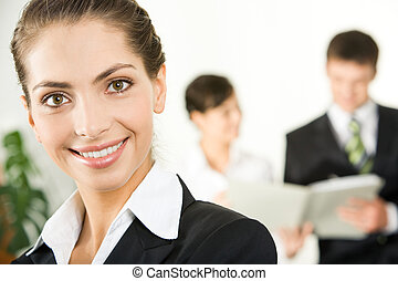 Beautiful lady - Portrait of pretty employee looking at...