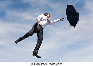 Flying ahead - Conceptual photo of businessman flying on his...