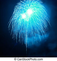 Blue fireworks on the black sky background