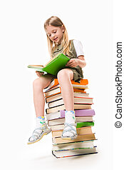 Reading - Image of schoolgirl sitting on the heap of books...