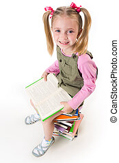 Learning lessons - Photo of little girl with book in hands...