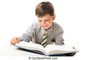 Diligent pupil - Photo of smart pupil lying and reading...