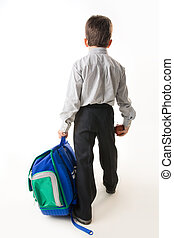 Again to school - Back of schoolboy holding backpack and...