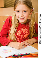 Schoolgirl - Portrait of schoolgirl drawing in her copybook...
