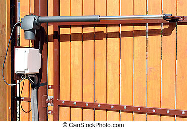The device for automatic opening/closing a gate