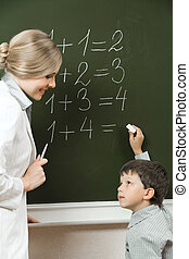 Consulting - Portrait of diligent pupil looking at his...