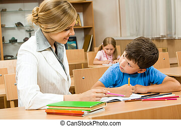 Teacher and pupil - Photo of teacher and schoolboy sitting...
