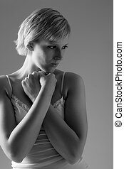 Beautiful blond in lingerie looking protective - Studio...