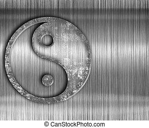 Yin yang symbol on metal background