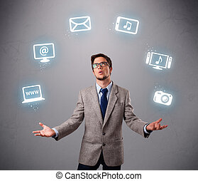 funny boy juggling with electronic devices icons - funny boy...