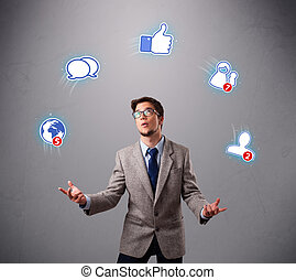 handsome young boy juggling with social media icons -...