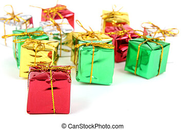 Holiday color gift boxes decorated with ribbon isolated on white background