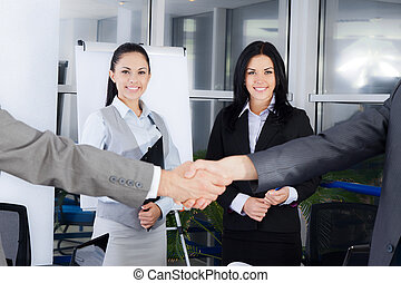 Business people - Business handshake with business people on...