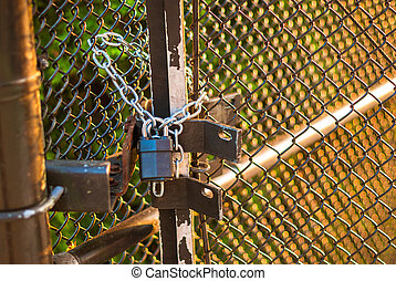 Padlock on wire fence - Padlock and chain holding wire fence...