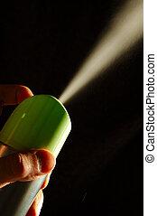 Spray - generic aerosol can spraying against dark background