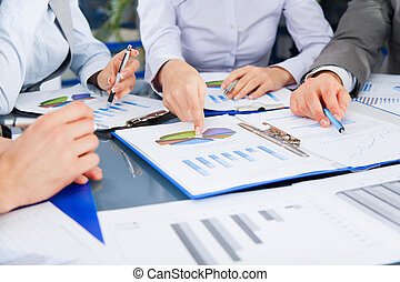 Business people team work group during conference discussing...