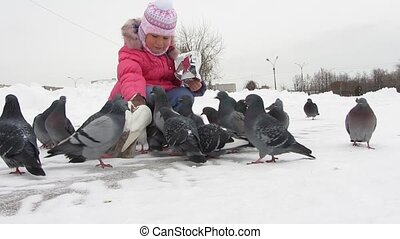 pigeons - winter, child feeding pigeons