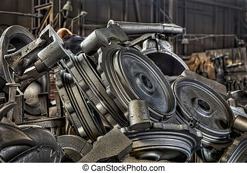 Stack of cast metal parts in a iron foundry